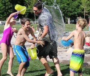 children having a water fight